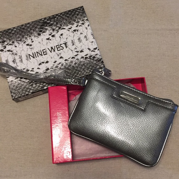 Nine West Handbags - Nine West Silver Clutch Wristlet NEW